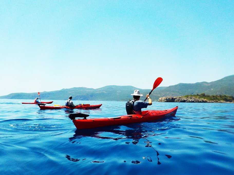 Kayaking In The Blue Waters